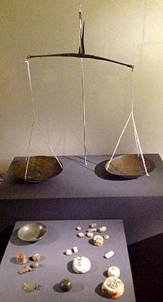 Viking traders used weights sets and bronze scales, some of which folded up on themselves, making for a very compact package for traveling. A more conventional Viking age scale and weight set is shown to the right.