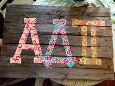 Adpi wooden sign made out of an old fence.