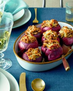 Sausage Stuffed Red Onions The onions in this dish aren't just for show; the long roasting time brings out their sweetness and makes them delicious in their own right, and they add just the right savory note to the stuffing inside. Thanksgiving Side Dishes, Thanksgiving Recipes, Thanksgiving Stuffing, Red Onion Recipes, La Trattoria, Sage Sausage, Veggie Sausage, Sausage Bread, Cheese Sausage