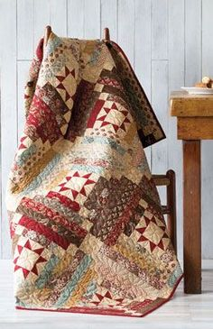 Libby's Log Cabin Quilt Project was designed using two traditional quilt blocks: Log Cabin and Variable Star. Intermediate project and fat quarter friendly.