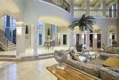 Mediterranean Living Room with Loft, simple marble tile floors, Sunken living room, Balcony, Columns, Nautilus sculpture