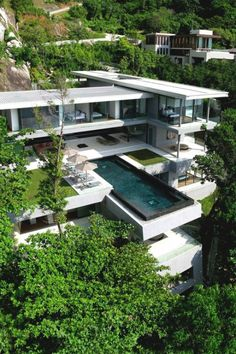 Villa Amanzi in Phuket, Thailand designed by Original Vision Architecture. The villa is nestled in a cascading, west facing ravine, with a dramatic granite slab at the northern edge, and the sparkling Andaman Sea to the south. Architecture Design, Amazing Architecture, Contemporary Architecture, Landscape Architecture, Architecture Interiors, Organic Architecture, Building Architecture, Residential Architecture, Creative Architecture