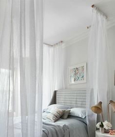 This simple DIY canopy is a quick and dramatic way to transform your bed into a serene sanctuary. With some simple hardware and a few extra-long sheer curtains, the look can be yours in less than an afternoon. Keep reading for my step-by-step guide.