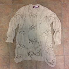 Cream Colored Lace Sweater Not American Eagle just listed for views. There is a hole in the lace but it isn't noticeable since it is right in the lace. American Eagle Outfitters Sweaters