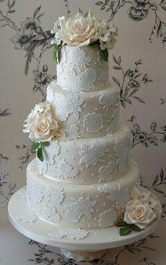 Ivory 4-tier wedding cake by Ozemandeus