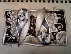 Dark and moody tangles on grey-toned paper.
