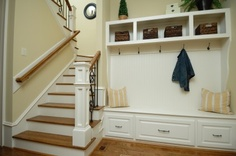 Shelf above, bench below, side molding (or decorative pieces), creates a functional non-closet for any space. Paint it all a nice accent-ish color