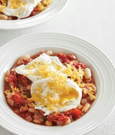 Poached eggs with a white bean and fire-roasted tomato ragu