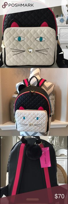 "Betsey Blk/Ivory Kitten Backpack This backpack is amazing! The beautiful blue eyes and generous outside pocket that measures11.5"" across & 9.5"". Back straps are pretty with the pink stripes to match the pink kitten ears! This will hold your notebook & other items. NWT Betsey Johnson Bags"