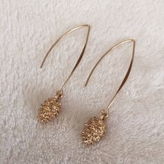 NWOT cutest ever earrings. Pinecones! Unrest ever earrings. Gold tone pinecones adorn your lobes. Trust me, compliments will roll in. I sport mine about 3x per week. My personal faves! Jewelry Earrings