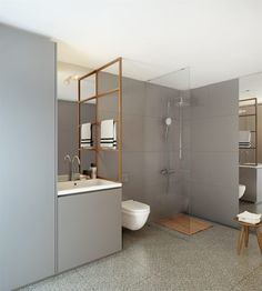 Like the alignment of the tiled wall finish, glass, towel bar/cabinet, and the linear drain spanning the tile and floor to ceiling mirror