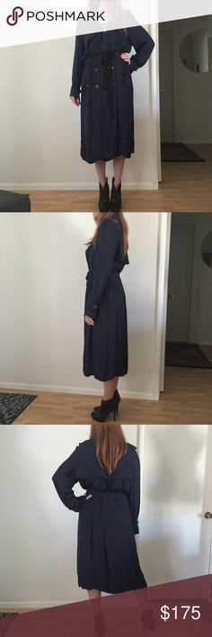 """Lanvin Navy Trench Coat Lightweight navy poly, has a silk feel to it. Double sided button closure, side pockets with button closure. Raw edge hems, it didn't have a belt so I've been using a skinny black sash. Preloved condition, no major damage that I could notice. Size 42 France, US size 10. Model is a size medium, 5'8"""". 50"""" long. Open to reasonable offers. Lanvin Jackets & Coats Trench Coats"""