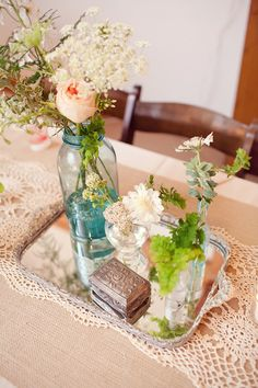 Vintage centerpiece decor- love the lace runner, silver tray, and eclectic combination of vintage items! (#aqua weddings, #vintage weddings)