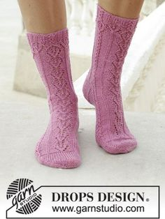 DROPS free knitting pattern for socks with lace pattern and small cables. Size 35-43. Piece is knitted in DROPS Fabel... See our great prices and fast service. Lace Knitting, Knitting Socks, Knitting Patterns Free, Knit Crochet, Tunisian Crochet, Drops Design, Magazine Drops, Lace Socks, How To Purl Knit