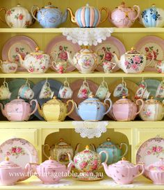 The china cabinet in our workroom.. pastel teapots, teacups, bits and pieces for your own high tea. www.thevintagetable.com.au