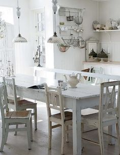French country style, with linen, monograms, antiques and church candelabras. Vintage, but chic!