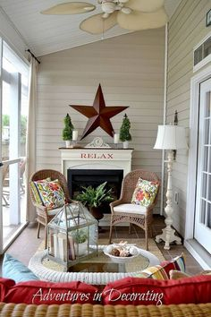 Great Porch Decor Love the Faux fireplace