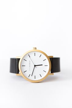 brushed gold/black leather watch.