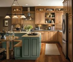 Light Maple Kitchen Cabinets Combined With Light Green Kitchen Island And Eat In The Kitchen Table Kitchen Cabinets Pictures, Maple Kitchen Cabinets, Kitchen Cabinetry, Kitchen Paint, New Kitchen, Kitchen Decor, Eclectic Kitchen, Kitchen Banquette, Kitchen Craft