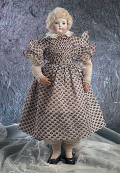 """Theriault's Antique Doll Auctions - French Bisque Poupee by Adelaide Huret, The body is stamped ›Huret, 34 Boul. Haussman, Paris"""".  circa 1860."""