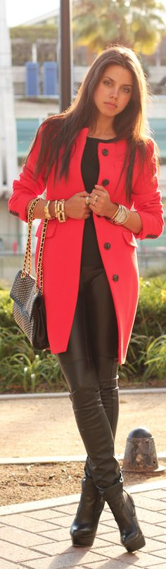 All black leather topped with a five button red coat. Love this coat