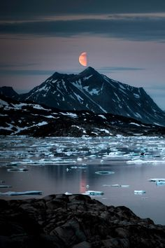 """tulipnight: """" Solitude and moon in East Greenland by greenland_com on Flickr. Photo by Mads Pihl. """""""