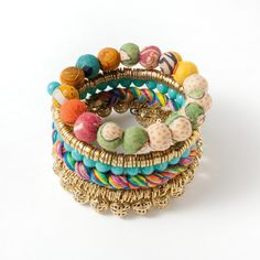 Lucknow Bracelet ($38) - Strands of recycled Kantha textiles are woven into the brass links of this multicolored bracelet by women working in a fair-trade cooperative in India. One-size fits all.