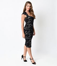 Reap something radiant! Presenting a retro ravishing fitted frock in a black crochet fabric smattered in dainty floral d...Price - $68.00-sNkTMwXz