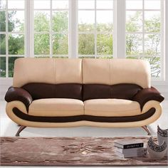 Real leather. Stylish. Quality wood construction. This sofa, with its smile-like form, is sure to brighten any room.