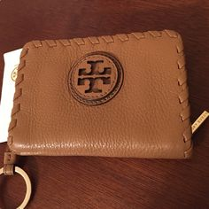 """Tory Burch Pebbled Leather Coin/Key case. NWT Style name is """"Marion"""" and the pebbled leather is in Royal Tan color. Zips around to keep secure your keys attached to key ring and has slots/pockets for cash ID and credit cards. Great to keep keys securely in the case and in your handbag for cars with keyless entry. Nice to give as a gift as it comes with a TB shopping bag and tissue paper. Tory Burch Accessories Key & Card Holders"""