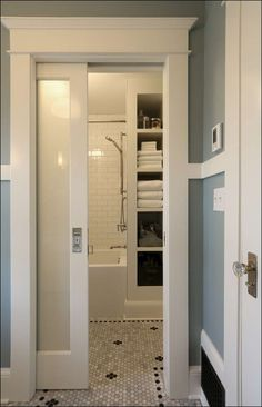 Frosted glass and wood pocket door for separate toilet closet. Small Basement Bathroom, Small Master Bathroom Ideas, Master Bathroom Designs, Bathroom Remodel Small, Classic Small Bathrooms, Showers For Small Bathrooms, Shelving In Bathroom, Small Bathroom Bathtub, Small Bathroom Makeovers