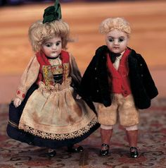 """Two 4"""" German all-bisque dolls in Trachten, circa 1910. Their brown stockings are rare."""
