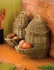 Plastic grocery bags retain moisture, speeding the demise of potatoes and onions. These breathable woven baskets, used for centuries in Europe, are a better solution. They fill from the top, and dispense vegetables from the pocket below. And they add a little country style to your kitchen or pantry. Set of two; large holds about 30 lbs. of potatoes, small holds about 6 lbs. of onions. Hand-woven willow with braided sea grass handles.