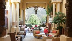 Will Smith' house - The living room features furnishings from 60s and a 1930 copper lantern.