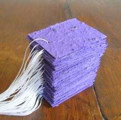 Plantable paper tags - wedding place cards - Purple tags made of handmade paper embedded with perennial and annual wildflower seeds-Great 1st day of Spring activity for kids. I would make them longer and use as a bookmark in a gardening books!
