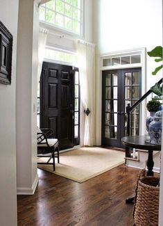Inviting charisma design  Paint the back door black. What about the front door and doors to dining room if I change the wall color in the foyer?
