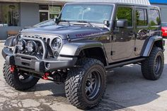 """3.5"""" Lift, 35"""" Toyo Open Country Tires, Fuel Anza 18"""", AEV Front Bumper with IPF 900 XS Lights JW Speaker Headlights Banks Cold Air Intake Recon LED Brakelights, Turn Signals, & Side Markers AEV Rear Bumper with Tire Carrier Rigid D2 6-bulb Windshield-mounted LED Lights Borla Stainless Steel Dual Exhaust Kit SPOD Switching System MyGig V5 Rear Back-up Camera Katzkin Leather Seats with Rubicon Logo Smittybilt Red D-Rings AEV CHSML(3rd Brake Light)"""