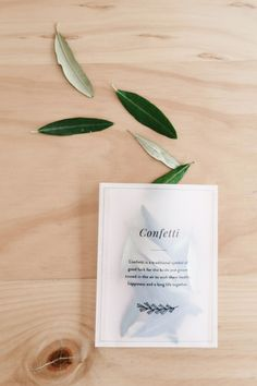 Pretty leaves make a lovely ceremony toss, especially when they're elegantly packaged in vellum envelopes like this and placed on each seat. Choose leaves that complement your wedding aesthetic—olive leaves (above) for an elegant outdoor celebration, or perhaps fall leaves like oak or maple for an autumnal wedding. You can download this free confetti-bag template here.