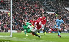 Ashley Young latches on to a loose ball and fires past the despairing dive of Hart to leve...