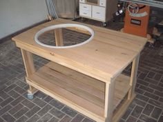 I recently completed a grill cart for my Weber Grill that greatly improves the functionality I think. The actual grill gets dropped in this weekend and I'll post a few more pics when that's all in. Grill Stand, Grill Cart, Webber Grill Table, Ideas Para Trabajar La Madera, Kettle Bbq, Weber Kettle, Bbq Table, Patio Table, Diy Grill