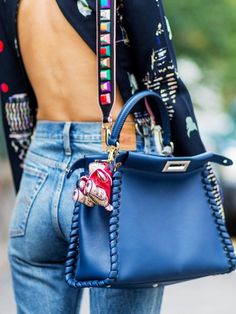 This purse adds the perfect amount of color to this look!