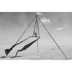 Playing in the air on the playa. A dust storm cleared for a few minutes and we found this point in the middle of the desert. Thanks to whoever set it up! ... #burningman #burningman2015 #x100t #bw #bnw #blackandwhite #blackrockcity #aerial #aerialsilks #aerialarts