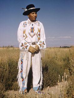 Shoshone man Modeling White Leather Beadworked Costume, Fort Hall Indian Reservation, Idaho by Eliot Elisofon