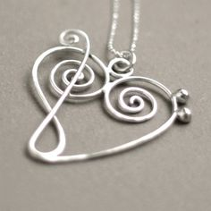music heart NECKLACE. treble clef meets bass clef. music jewelry in sterling silver