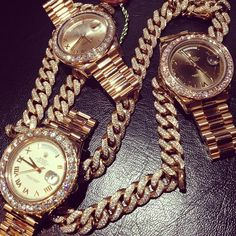 Cuban Link gold diamond encrusted  chain with Rolex presidential