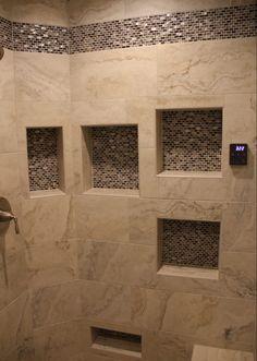 Shower Walls: Darwin 10x20 – Floreana; Shower Accent Tile: Quintessa – Grey Pearl Glossy/Matte Mosaic – Grey Pearl