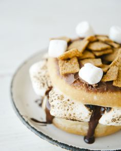 Gooey, crunchy, oozing with chocolate - the s'mores doughnut has become one of my new favorite summertime treats!