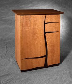 Cabinet with two cupboards and three drawers. Rippled maple (saw-cut veneer), black walnut and Trespa. Sycamore internally. Guide price: £8,500