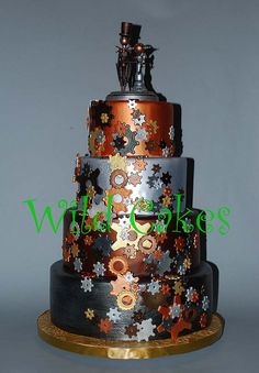 Four-Tiered Steampunk Wedding Cake Covered In Zing And Bling.