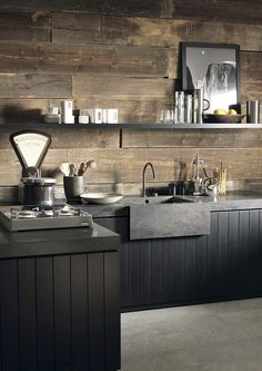 The rich hue of Corian Lava Rock has been used here to create both a robust kitchen worksurface